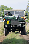 Renowned father and son Adams in one of their beautifully restored ex-army Land Rover 101. Dunsfold Collection of Land Rovers Open Day 2011, Dunsfold, Surrey, UK. --- No releases available, but releases may not be necessary for certain uses. Automotive trademarks are the property of the trademark holder, authorization may be needed for some uses.
