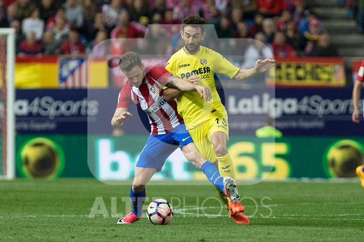 Saul Iniguez of Atletico de Madrid holds off pressure from  Adrian Lopez of Villarreal during the match of La Liga between Atletico de Madrid and Villarreal at Vicente Calderon  Stadium  in Madrid, Spain. April 25, 2017. (ALTERPHOTOS/Rodrigo Jimenez)
