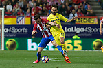 Saul Iniguez of Atletico de Madrid holds off pressure from  Adrian Lopez of Villarreal during the match of La Liga between Atletico de Madrid and Villarreal at Vicente Calderon  Stadium  in Madrid, Spain. April 25, 2017. (ALTERPHOTOS/Rodrigo Jimenez)