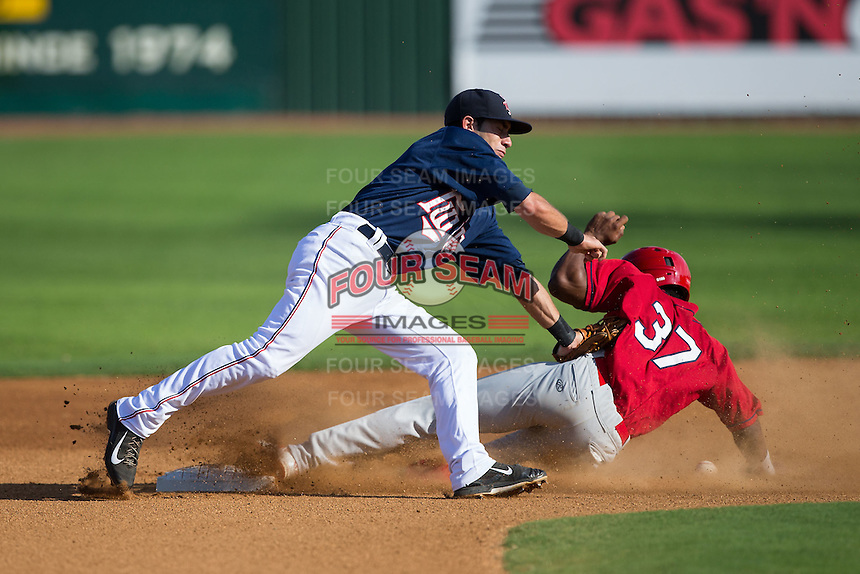 Alex Perez (8) of the Elizabethton Twins reaches for a throw as Magneuris Sierra (37) of the Johnson City Cardinals slides into second base at Joe O'Brien Field on July 11, 2015 in Elizabethton, Tennessee.  The Twins defeated the Cardinals 5-1. (Brian Westerholt/Four Seam Images)