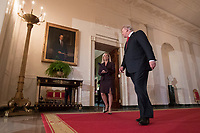 US President Donald J. Trump (R) walks from the Green Room into the Cross Hall to the East Room, with Kirstjen Nielsen (L), before announcing her as his nominee for the position of Secretary of Homeland Security, at the White House in Washington, DC, USA, 12 October 2017.<br /> Credit: Michael Reynolds / Pool via CNP /MediaPunch