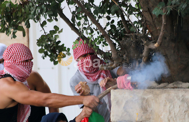 Palestinian protesters shoot fire crackers at Israeli security forces during clashes in the West Bank city of Bethlehem, on October 13, 2015. A wave of stabbings that hit Israel, Jerusalem and the West Bank this month along with violent protests in annexed east Jerusalem and the occupied West Bank, has led to warnings that a full-scale Palestinian uprising, or third intifada, could erupt. The unrest has also spread to the Gaza Strip, with clashes along the border in recent days leaving nine Palestinians dead from Israeli fire. Photo by Muhesen Amren