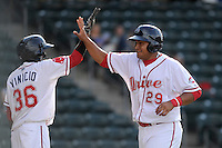 First baseman Boss Moanaroa (29) of the Greenville Drive, right, is congratulated after scoring a run by Jose Vinicio  in a game against the Hickory Crawdads on Friday, June 7, 2013, at Fluor Field at the West End in Greenville, South Carolina. Greenville won the resumption of this May 22 suspended game, 17-8. (Tom Priddy/Four Seam Images)