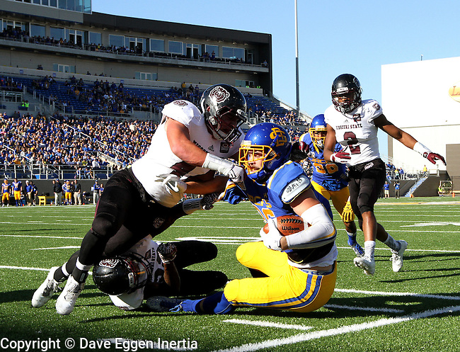 BROOKINGS, SD - NOVEMBER 5:  Dallas Goedert #86 from South Dakota State is brought down by a pair of defenders including Alexz Jones #44 form Missouri State in the first half Saturday afternoon at Dana J. Dykhouse Stadium in Brookings. (Photo by Dave Eggen/Inertia)