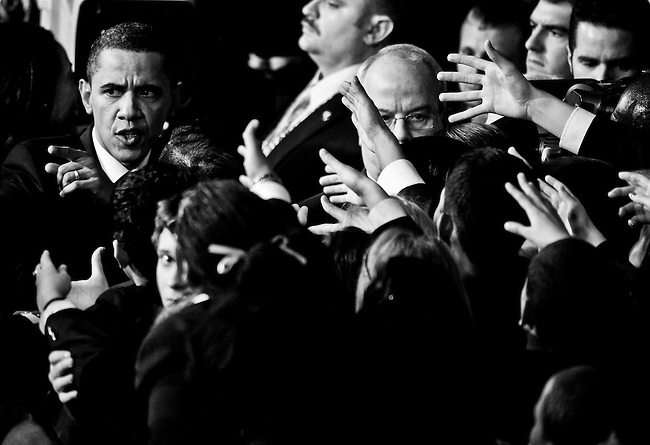 Pages reach to shake hands with President Barack Obama as he exits the House chamber following his State of the Union Address on Jan. 27, 2010.
