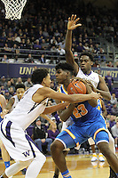 JAN 1, 2016:  Washington's #4 Matisse Thybulle and #15 Noah Dickerson try to box out UCLA's #23 Tony Parker under the basket.  Washington defeated #25 ranked UCLA 96-93 in double overtime at Alaska Airlines Arena in Seattle, WA.
