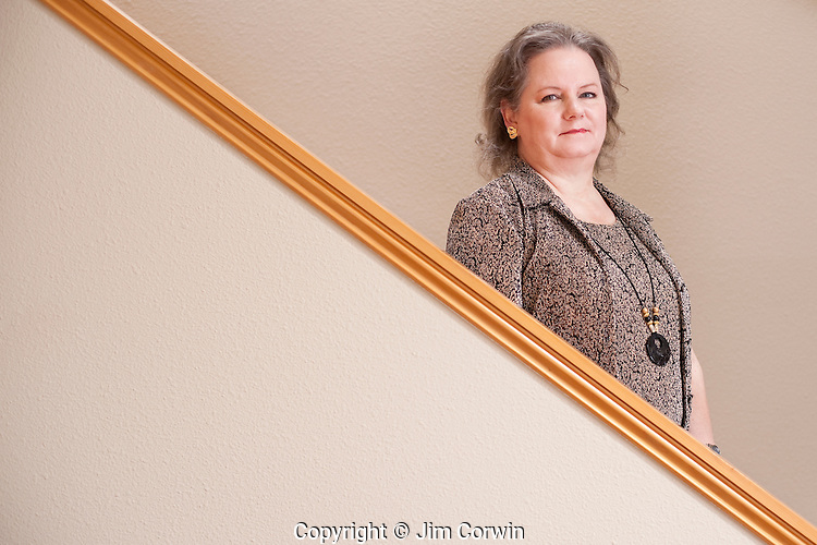 Woman's portrait standing on stairs