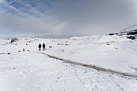 WEATHER PICTURE WALES<br /> Pictured: A couple walk on the snow covered Black Mountains near Brynamman, Wales, UK. Wednesday 23 January 2019