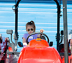 WOODBURY,  CT-052119JS04- Aria Galullo, a kindergarten student at Mitchell Elementary School, gets to sit on a tractor as students toured the Nonnewaug High School AG Department on Tuesday. <br /> Jim Shannon Republican American
