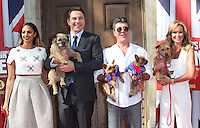 Alesha Dixon, David Walliams, Simon Cowell, Amanda Holden and their dogs attending a photocall for 'Britain's Got Talent' at St Luke's Church, London. 09/04/2014 Picture by: Alexandra Glen / Featureflash