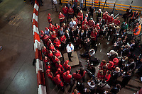 Conservative Party leader David Cameron takes questions from workers at a Coca Cola factory in Wakefield.