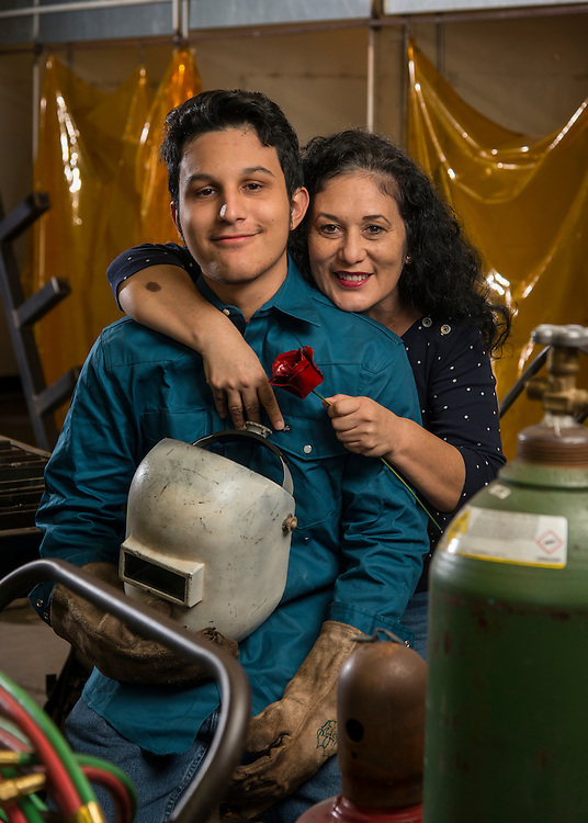 Victor Rodriguez poses for a photograph with his mother, Rosa, in the welding lab at Milby High School, January 6, 2017.