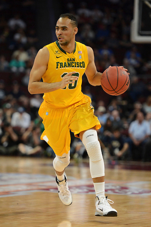 March 10, 2014; Las Vegas, NV, USA; San Francisco Dons guard Adams Adams Chris (10) dribbles against the Brigham Young Cougars during the first half of the WCC Basketball Championships at Orleans Arena.