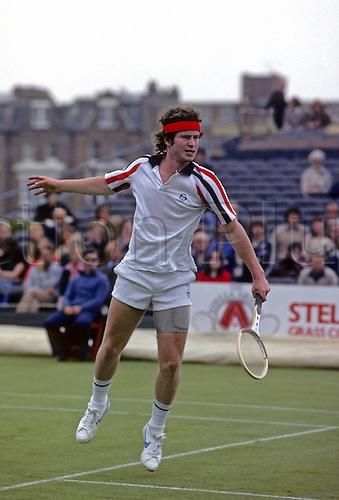 June 1979: John McEnroe plays a backhand during a men's singles match at the Stella Artois tournament at Queens Club. Photo: Leo Mason/Actionplus....7906 tennis mans