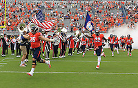 Virginia football players enter the field during the game in Charlottesville, VA. Virginia lost to UCLA 28-20. Photo/Andrew Shurtleff