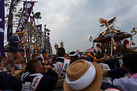 Mikoshi gather on Southern Beach at dawn during the Hamaorisai matsuri in Chigasaki, Kanagawa, Japan. Monday July 17th 2017.  This festival is celebrated on Marine Day in Japan. Over 40 mikoshi (portable shrines) are paraded through the night to arrive on the coast at Southern Beach where they are blessed in a Shinto ritual before being carried into the waves to be purified.