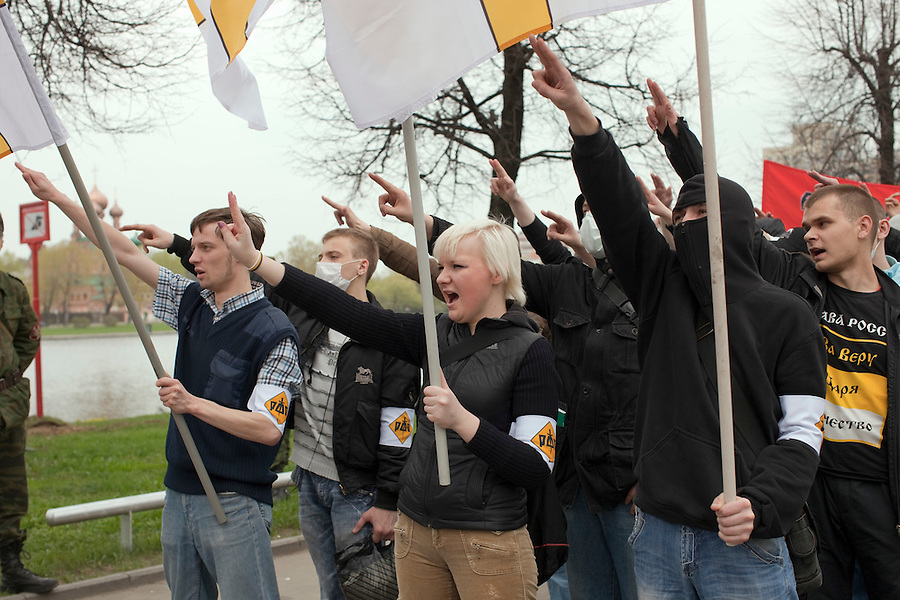 Moscow, Russia, 01/05/2010..Russian fascists make neo-nazi salutes in central Moscow. A variety of political groups took to the streets on the traditional Russian Mayday holiday.