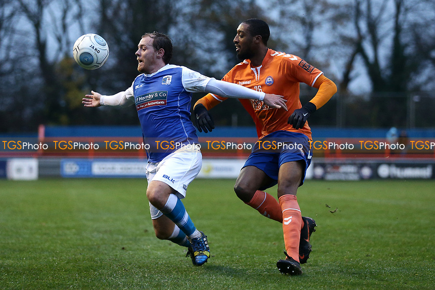 Jack Barthram of Barrow and Ricky Gabriel of Braintree during Braintree Town vs Barrow, Vanarama National League Football at the IronmongeryDirect Stadium on 1st December 2018