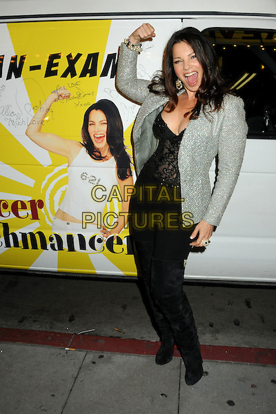 "FRAN DRESCHER .""The Million Dollar Revival"" Benefit for Fran Drescher's Cancer Schmancer Charity Movement held at the Million Dollar Theatre, Los Angeles, California, USA..December 13th, 2009.full length black grey gray jacket top corset lace jeans denim hand arm flexing silver thigh high boots jewel encrusted embellished sparkly mouth open .CAP/ADM/BP.©Byron Purvis/AdMedia/Capital Pictures."