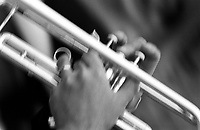 Black & white close up of hands playing a trumpet. New Orleans Louisiana United States French Quarter.
