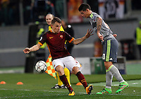 Calcio, andata degli ottavi di finale di Champions League: Roma vs Real Madrid. Roma, stadio Olimpico, 17 febbraio 2016.<br /> Real Madrid's James Rodriguez, right, is chased by Roma's Lucas Digne during the first leg round of 16 Champions League football match between Roma and Real Madrid, at Rome's Olympic stadium, 17 February 2016.<br /> UPDATE IMAGES PRESS/Riccardo De Luca