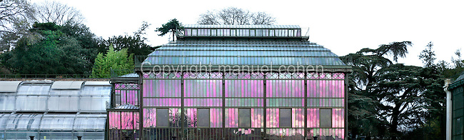 "Plant History Glasshouse (formerly Australian greenhouse), 1834, Charles Rohault de Fleury, Jardin des Plantes, Museum d'Histoire Naturelle, Paris, France. Panoramic view of the glasshouse seen in a morning light with the seeds incubators (called ""les couveuses"") on the left."