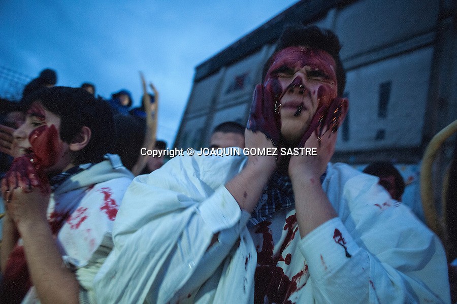 The participants in the carnival of Alsasua smear their faces and bodies with animal blood
