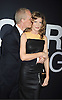 """actress Rene Russo and husband Dan Gilroy attends the World Premiere of """"The Bourne Legacy"""" on July 30, 2012 at The Ziegfeld Theatre in New York City. The movie stars Jeremy Renner, Rachel Weisz, Edward Norton, Stacy Keach, Dennis Boutsikaris and Oscar Isaac."""