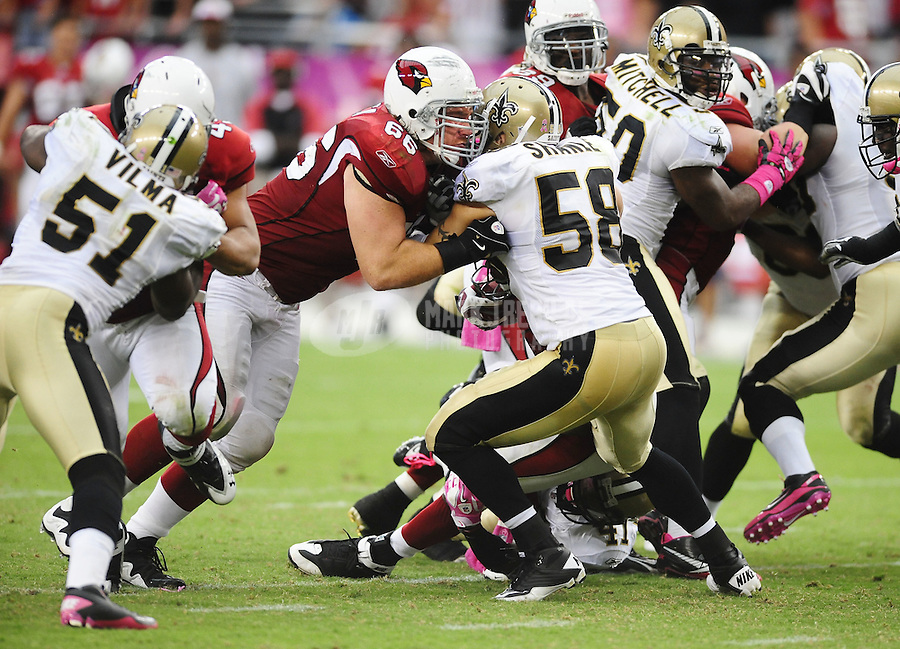 Oct. 10, 2010; Glendale, AZ, USA; Arizona Cardinals guard (66) Alan Faneca battles New Orleans Saints linebacker (58) Scott Shanle at University of Phoenix Stadium. The Cardinals defeated the Saints 30-20. Mandatory Credit: Mark J. Rebilas-