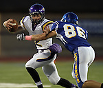 SIOUX FALLS, SD - OCTOBER 11:  Logan Gabriel #2 From Watertown tries to escape the grasp of Spencer Hopkins #86 from O'Gorman in the first quarter of their game Friday night at O'Gorman.  (Photo by Dave Eggen/Inertia)