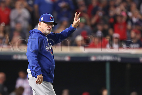 02.11.2016. Cleveland, OH, USA.  Chicago Cubs manager Joe Maddon (70) calls to the bullpen during game 7 of the 2016 World Series against the Chicago Cubs and the Cleveland Indians at Progressive Field in Cleveland, OH. Chicago defeated Cleveland 8-7 in 10 innings.