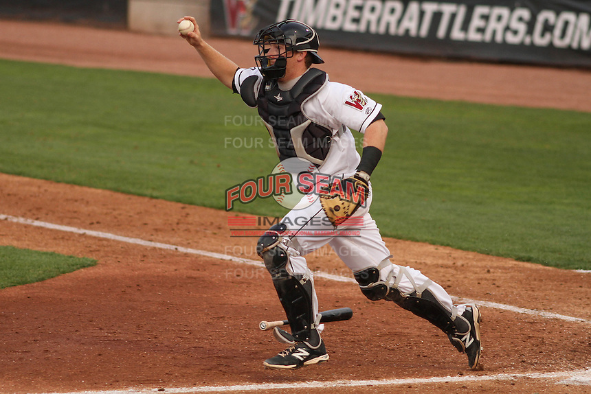 Wisconsin Timber Rattlers catcher Gregory McCall (21) chases a runner back to third base during a game against the Cedar Rapids Kernels on May 4th, 2015 at Fox Cities Stadium in Appleton, Wisconsin.  Cedar Rapids defeated Wisconsin 9-3.  (Brad Krause/Four Seam Images)