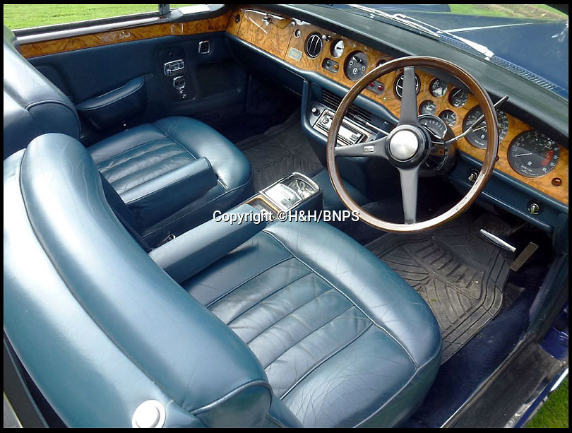 BNPS.co.uk (01202 558833)<br /> Pic: H&H/BNPS<br /> <br /> Nice to drive you, to drive you nice - If you play your cards right you could pick up Brucie's old Roller.<br /> <br />  A classic Rolls-Royce, formally owned by the late Sir Bruce Forsyth, has emerged for sale, nearly 40 years after it was sold by the former Strictly Come Dancing host.<br /> <br /> The Rolls-Royce Corniche Convertible dates back to 1971 and was owned from new by the legendary entertainer until 1978.<br /> <br /> Since then it has had a string of other owners including Alpine Grant - the brother of musician Eddie Grant.<br /> <br /> The car itself is in pristine condition and its blue bodywork appears as new. <br /> <br /> Under the bonnet the car has a 6750cc V8 engine and could reach speeds of over 100mph.<br /> <br /> Over the years the soft top Corniche has been a real favourite for the rich and famous with other celebrities to own one including Paul McCartney, David Bowie, Tom Jones and Frank Sinatra.<br /> <br /> This one came into the possession of its current owner, and vendor in 2006, but now following Forsyth's recent death he has decided to sell it.<br /> <br /> It is being sold by H&H auctioneers, Cambridgeshire, and could be yours for £50,000