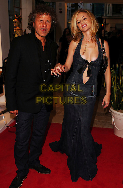 RENZO ROSSO & HEATHER GRAHAM.Diesel - store launch party, Diesel, 130 New Bond Street, London, UK..May 18th, 2006.Ref: CAN.full length denim jeans jean dress black shirt plunging neckline cleavage belly stomach holding hands.www.capitalpictures.com.sales@capitalpictures.com.© Capital Pictures.