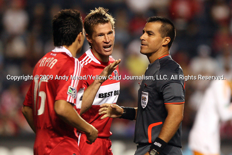 05 June 2009: Chicago's Brian McBride (center) and Marco Papa (left) complain to referee Ricardo Salazar (right). The Houston Dynamo defeated the Chicago Fire 1-0 at Toyota Park in Bridgeview, Illinois in a regular season Major League Soccer game.