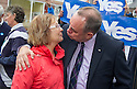 First Minister Alex Salmond gets a kiss from undecided voter Rose Michie, 69 whilst touring Turriff