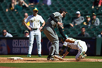 Missouri Tigers first baseman Brandt Belk (21) comes off the bag to field a throw as Chase Wehsener (37) of the Baylor Bears tries to avoid the tag in game one of the 2020 Shriners Hospitals for Children College Classic at Minute Maid Park on February 28, 2020 in Houston, Texas. The Bears defeated the Tigers 4-2. (Brian Westerholt/Four Seam Images)
