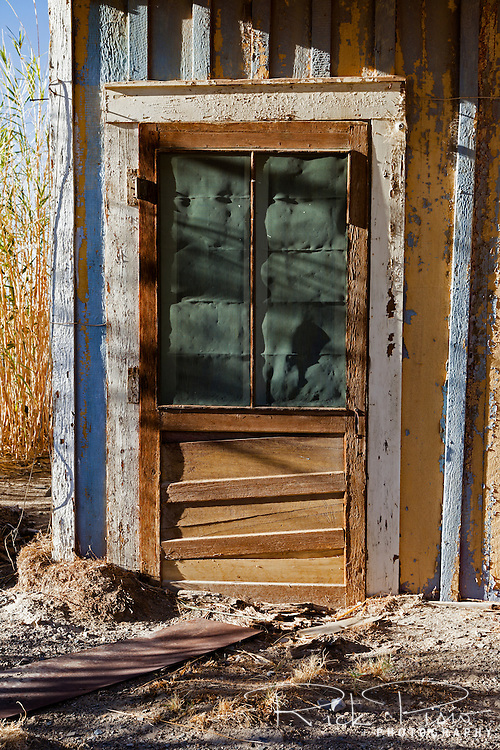 Weathered door at the Keeler Railroad Depot in Keeler, California, on the east side of the now dry Owens Lake. Keeler was the end of the line for the now abandoned Carson and Colorado Railroad.