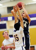 La Crosse Aquinas' Bronson Koenig takes a jump shot over DeForest's Allen Castillo on Tuesday, 12/18/12, in DeForest, Wisconsin | Greg Dixon photos accompanied Dennis Semrau article in the Wisconsin State Journal on 12/19/12 and on-line at http://tinyurl.com/Bronson-Koenig-DeForest-WI