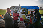 © Joel Goodman - 07973 332324 . 26/01/2014 . Salford , UK . People gather in front of a caravan at the protest camp . Protesters march to an iGas fracking exploration site at Barton Moss , Salford , today (Sunday 26th January 2014) . A long term protest camp has been established on an access road leading to the site and today (26th January) protesters from other areas of the country travelled to the site to join with other protesters against fracking . Photo credit : Joel Goodman