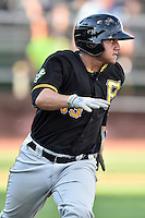 Bristol Pirates catcher Yoel Gonzalez (13) runs to first base during a game against the Elizabethton Twins at Joe O'Brien Field on July 30, 2016 in Elizabethton, Tennessee. The Twins defeated the Pirates 6-3. (Tony Farlow/Four Seam Images)