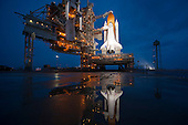 The space shuttle Atlantis is seen shortly after the rotating service structure (RSS) was rolled back at launch pad 39a, Thursday, July 7, 2011 at the NASA Kennedy Space Center in Cape Canaveral, Florida.  Atlantis is set to liftoff Friday, July 8, on the final flight of the shuttle program, STS-135, a 12-day mission to the International Space Station.  .Mandatory Credit: Bill Ingalls / NASA via CNP