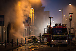 © Joel Goodman - 07973 332324 . No syndication or onward sale permitted . 13/07/2013 . Manchester , UK . More than 60 fire fighters tackle a blaze at a shop on Oldham Street in Manchester City Centre this evening (Saturday 13th July 2013) . Two people had to be taken to hospital , one with burns who had tried to fight the fire and another suffering from smoke inhalation . Twelve crews from four stations are battling the blaze which started in a store room in Paul 's Hair World this afternoon . Several streets in a block in the city centre are sealed off . Photo credit : Joel Goodman
