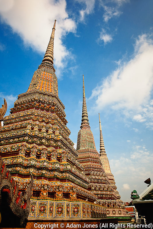 Upward view of trio of chedi, Wat Pho, Bangkok, Thailand