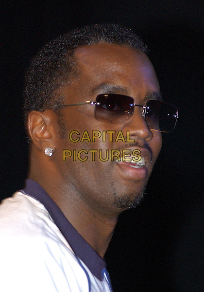 """P.DIDDY AKA SEAN COMBS.Speaks at the """"Citizen Change - Vote or Die!"""" event at Club Empire,  Pittsburgh, PA, USA, October 27th 2004. .portrait headshot diamond earrings Puffy Puff Daddy sunglasses P Diddy.**UK SALES ONLY**.Ref:ADM.www.capitalpictures.com.sales@capitalpictures.com.©JN/AdMedia/Capital Pictures ."""