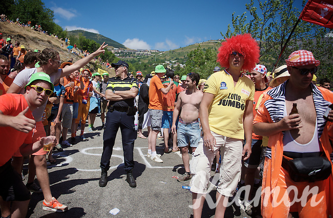 Although the Dutch Corner (nr7) up Alpe d'Huez is only a good 200 meters long, a delegation of Dutch Policemen is at the scene to make sure all will be safe for the peloton to come through (sort of...)<br /> <br /> stage 20: Modane Valfréjus - Alpe d'Huez (111km)<br /> 2015 Tour de France