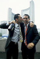 July 4th 2003, Toronto (ON) CANADA<br /> <br /> <br /> Marcelo Gomez-W. (L) and   Mathieu Chantelois (R)<br /> celebrate in front of Toronto.s City Hall, after dbeeing married, July 4th 2003<br /> <br /> They are among the first gay coiple in North-America to have a same sex civil wedding.<br /> Chnateloix is a TV host at Pride Vision, the first Canadian chain about  Gays and Lesbians.<br /> <br /> Photo (c) by Mathieu Chanteloix<br /> Mandatory photocredit : dr/images Distribution
