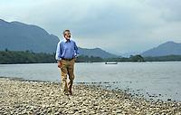 Following his leader's address Sinn Fein President Gerry Adams takes a stroll by Lough Lein in Killarney. Photo: Don MacMonagle