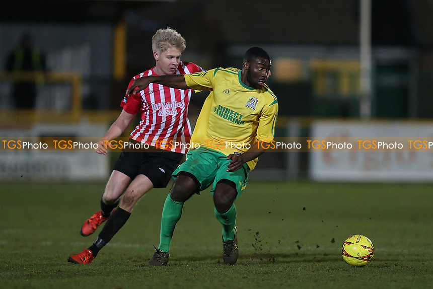 Mark Onyemah of Thurrock evades Alex Bentley of Hornchurch during Thurrock vs AFC Hornchurch, Ryman League Division 1 North Football at Ship Lane on 3rd January 2017