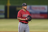 AZL Diamondbacks relief pitcher Ezequiel De La Cruz (14) checks the runner at first base during an Arizona League game against the AZL Angels at Tempe Diablo Stadium on July 16, 2018 in Tempe, Arizona. The AZL Diamondbacks defeated the AZL Angels by a score of 4-3. (Zachary Lucy/Four Seam Images)
